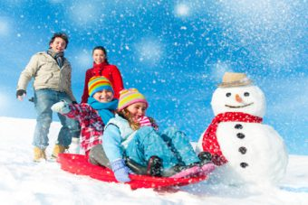 Family enjoying Winter Sledging